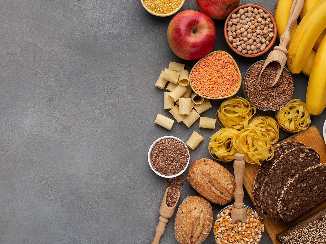 Assortment of food rich on fiber and carbohydrates on gray