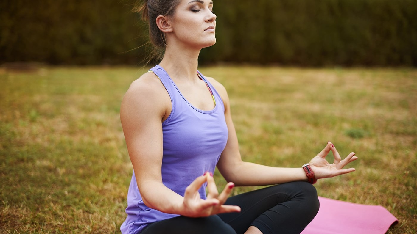 Woman meditating with nasal breathing