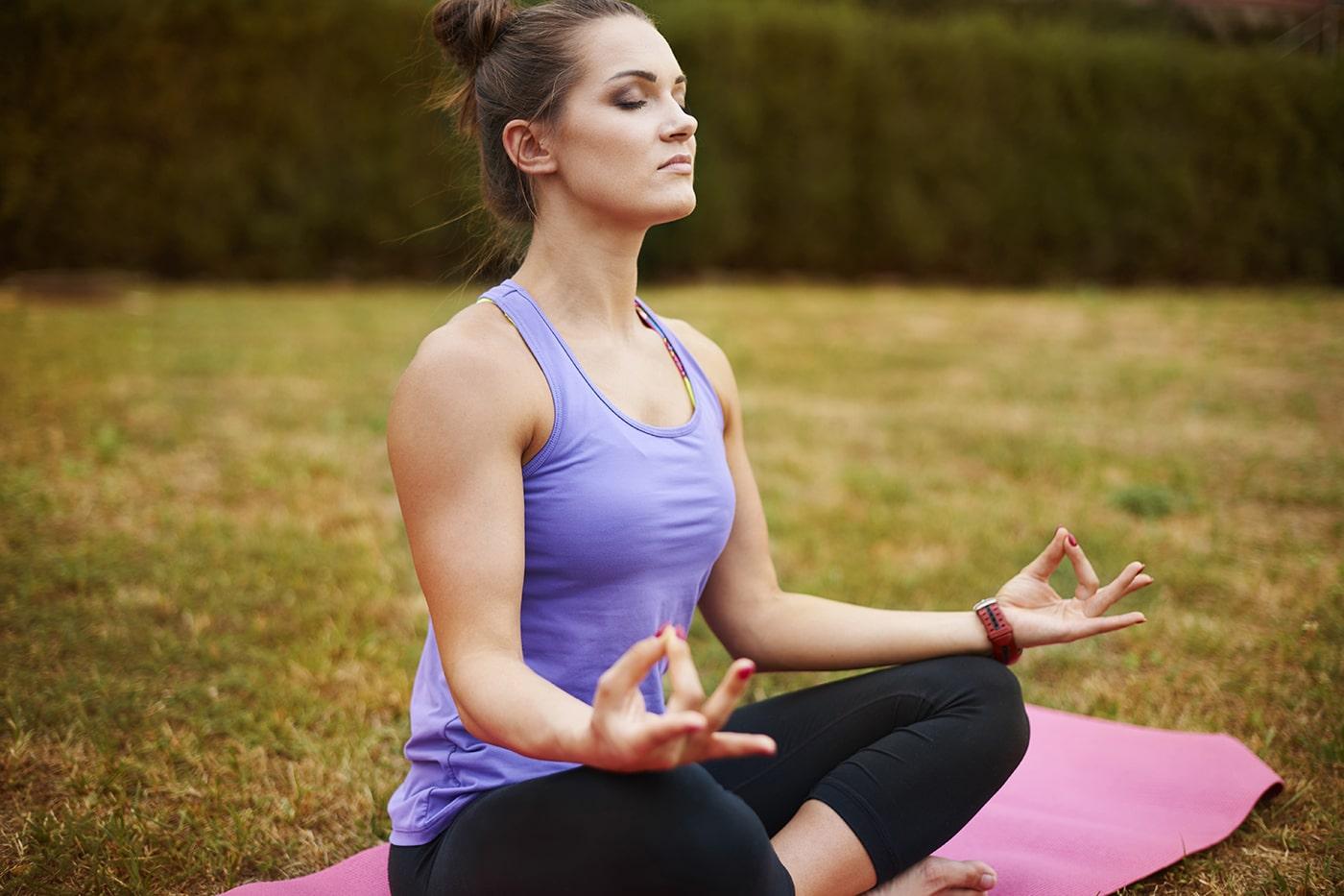 Woman meditating with nasal breathing